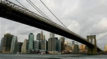 Time Lapse looking up at Brooklyn Bridge in Manhattan