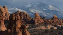 Formations And Snowy Mountains At Arches National Park