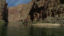 Float Slowly Down River, Surrounded By Steep Walls In Grand Canyon