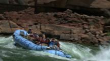 River Raft Full Of People Go Through Rapids
