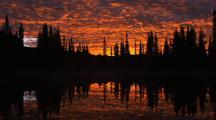 Bright Red Sunrise At Reflection Lake