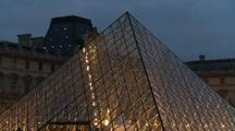 Louvre Museum With Pyramid Lit Up At Dusk