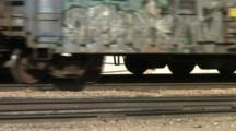 Tight Shot Of Train And Train Wheels Passing Over The Tracks Of A Railway Yard In Nevada.