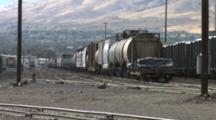 Train Cars Sitting In A Railway Yard In Nevada.
