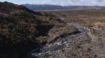 Aerial, Tracking Down Small River From The Side Of Mount Ruapehu, Nz
