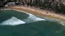 Aerial Over Sydney Area Coastline, Manly Beach, Surfers In Water