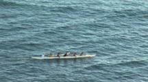 Hawaiian Outrigger Canoe Paddling Across The Ocean In Waikiki, Hawaii