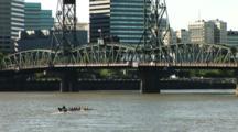 Oarsmen Training On The Willamette River In Portland, Oregon.