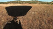 Shadow Of A Hot Air Balloon Flying Low Across The Sedona, Arizona Landscape