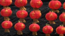 Chinese Red Paper Lantern Swaying In The Wind