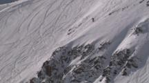 Person Downhill Skiing On Steep Mountainside, Small Jump