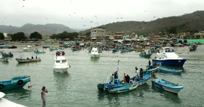 Wide Shot, view of the fish market and the Town of Puerto Lopez.