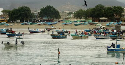 Medium Shot,Pan, view of the fish market and the Town of Puerto Lopez.