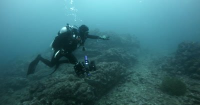 A Medium Shot of a Diver Removing A long line Fishing wire.