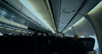 Day Time Lapse, Wide Shot inside an airplane with the passengers seated.