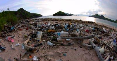 Pan across a littered Pink beach Bay,Pantai Merah.