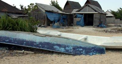 Wide Shot, panning from the Rural Village, at Jungut Batu, to the Seaweed farming area. Jungut Batu.(Eucheuma spp)