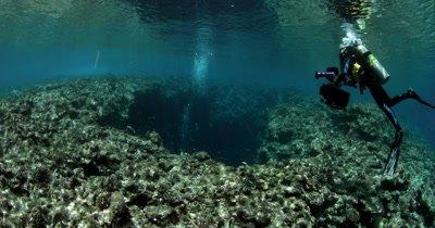 Divers entering Blue Holes Cave, Palau