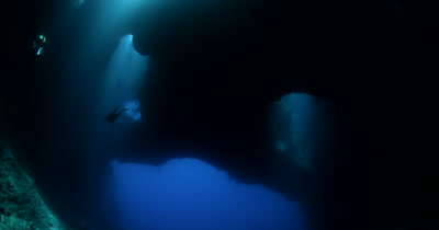 Divers diving in the Blue Holes Cave, Palau