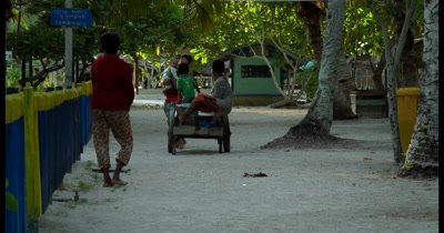 Villagers relaxing in the street