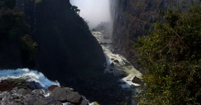 Reveal Side view of the mist of  Victoria Falls,Zimbabwe on the Zambezi River