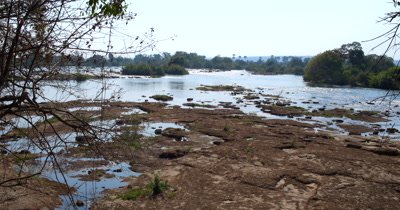 Pan across the Zambezi River at the top of Victoria falls