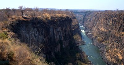 Pan across the valley of the Zambezi river,showing the bungee jumping activities available at Victoria Falls