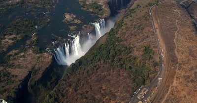 Aerial shot of Victoria falls with a rainbow glistening
