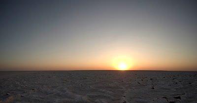 Time lapse of the Sunset over the crisp Makgadikgadi salt Pans