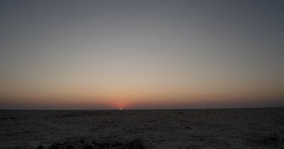 Time lapse of the Sunrise over the crisp Makgadikgadi salt Pans
