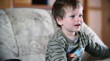 Little Boy Watching Cartoons On Laptop