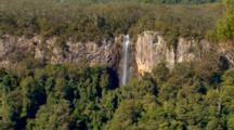 Wide Pan Of Cliffs To Rainbow Falls, Queensland