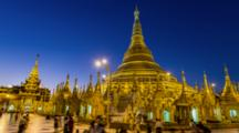 Shwedagon Pagoda In Rangoon,Myanmar, Timelapse Day Night Transition Of The Famous Landmark, Pilgrims Honor The Sacred Buddhist Site