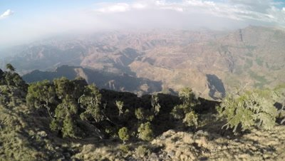 Simien mountains 4K aerial, semi circle move along the cliff