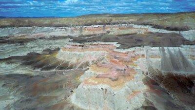 Sarmiento aerial over colorful rocks, tilt down