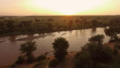 Move along african river at sunrise, 4k Aerial