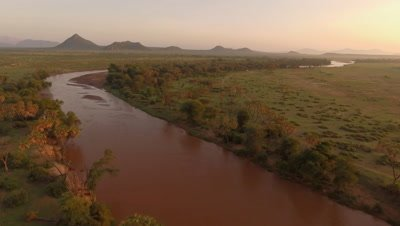 Ewaso Nyiro River in morning light, forward move 4k Aerial