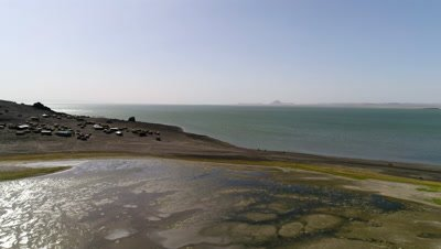 Lake Turkana move over shore towards El Molo village, 4k Aerial