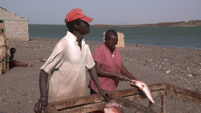 El Molo Village man and woman cleaning fish, various shot sizes, UHD 4K