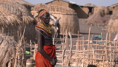 El Molo Village pan from man to a grpup of women, UHD 4K