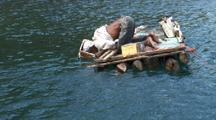 Fisherman On Balsa Raft
