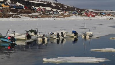 fishing boats pulled up on the ice,safe mooring ,inuit village