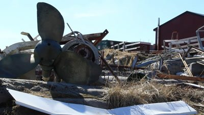 parts from a shrimp trawler left on land after the shrimp fishing ended caused by overfishing