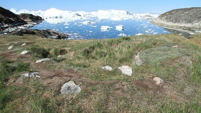 Inuit settlement in the Ilulissat tundra,glacial ice drifting in the fjord,Unesco world heritage site