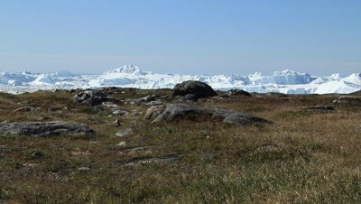Arctic tundra in the Ilulissat ice fjord,glacial ice bergs drifting in the fjord,Unesco world heritage site