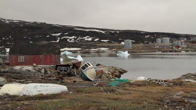 Abandoned whaling operation,northern Greenland village,modern oil storage in the background