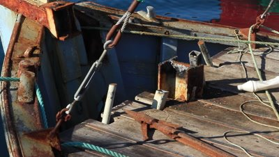 Fishingboat with the whaling cannon dismantled,residues remains on the boat,harpoon left on the deck