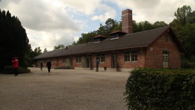 Turists visiting the cremation building in Dachau concentration camp
