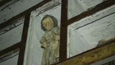Mummified little girl standing on a shelve in the caputine catacomb