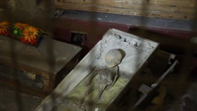 Mmmified little boy resting in his coffin in the capuchin catacomb